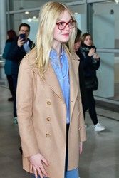 Elle Fanning - At Charles de Gaulle Airport in Paris 3/3/19
