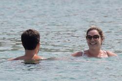 Kelly Brook in White Bikini on the Beach in Mykonos 05/26/20189c958b876420744