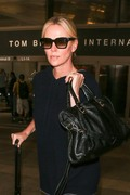 Charlize Theron - At LAX Airport 7/25/18
