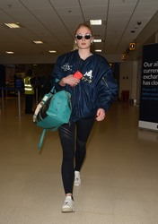 Sophie Turner - Seen arriving at Aberdeen airport for Kit Harington and Rose Leslie wedding - June 22, 2018