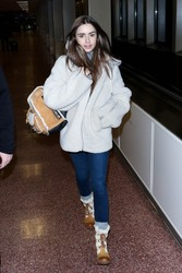 Lily Collins - Arriving in Park City, Utah 1/25/19