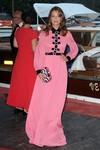 Valeria Bilello battles the wind at The Franca Sozzani Award red carpet during the Venice Film Festival 9/1/17