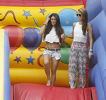 Casey Batchelor flashes her bra going down a bouncy castle slide in Essex 7/28/14