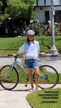 Shiri Appleby - Posing in shorts with her Bike