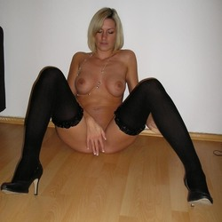 Blonde German woman makes horny nude pictures of herself
